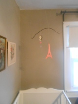 A hot air balloon and Eiffel Tower mobile for above Margot's bed.
